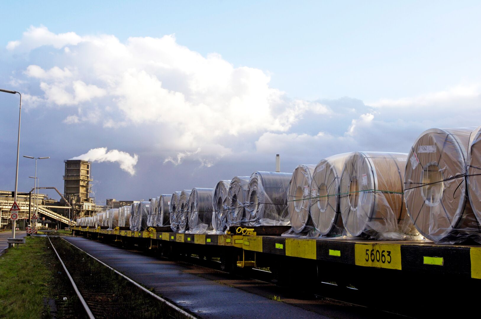 Steel coils stacked, ready for transportation