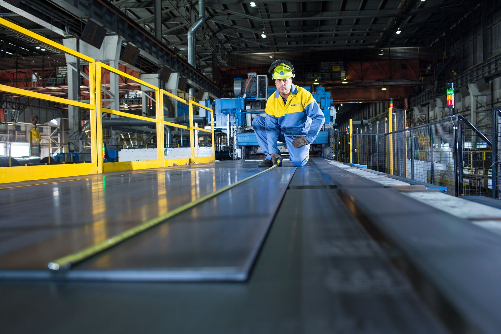 Tata Steel operator measuring steel sheet