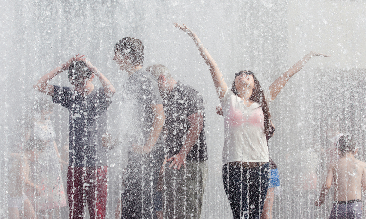 People in the Jeppe Hein Fountain at the Southbank Centre