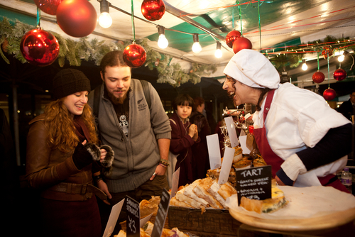 Market vendors selling goods at the Winter Market, Southbank Centre