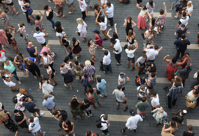 View looking downwards at people dancing outside at Southbank Centre