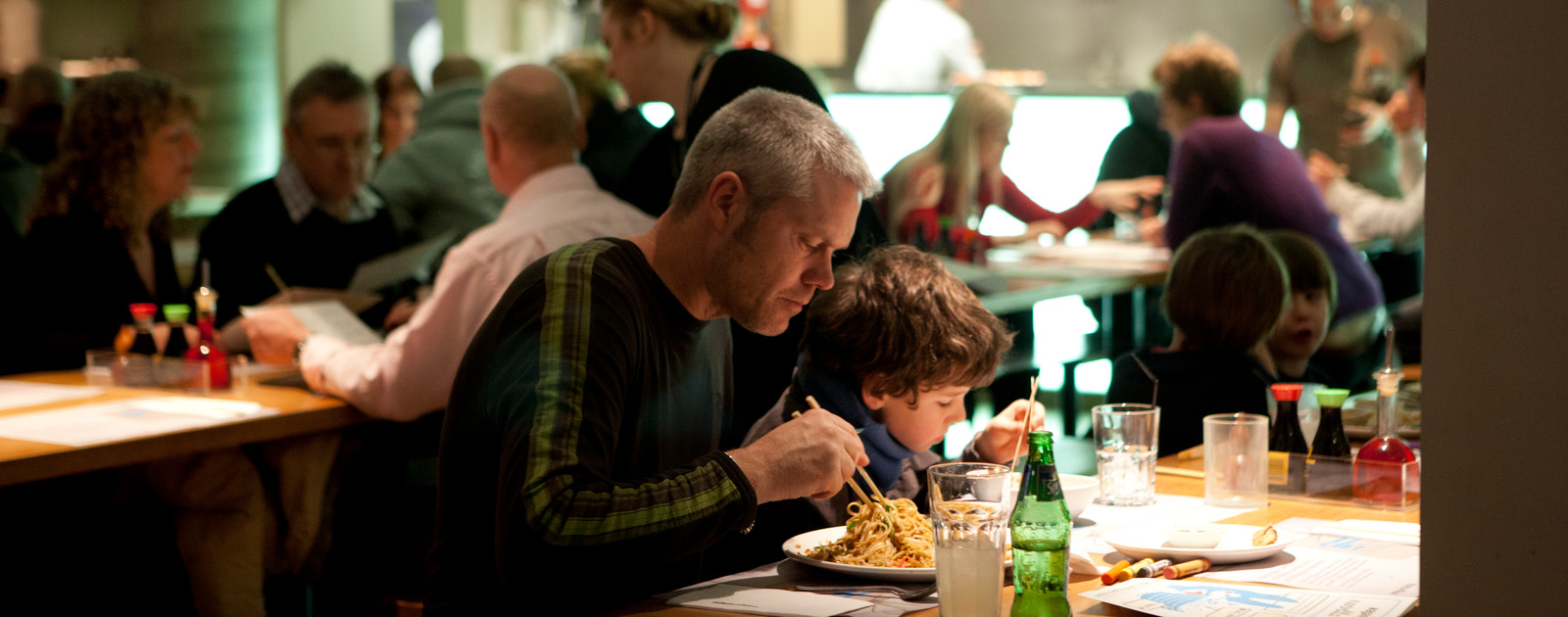 Father and son enjoying dinner at Wagamamas at the Southbank Centre
