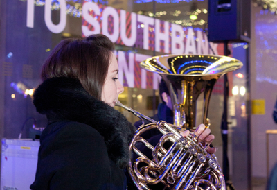 Young Girl Playing Brass Instrument outside the Southbank Centre
