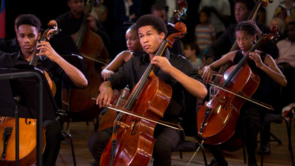 Young male musician from the Chineke! Junior Orchestra performing during Africa Utopia at Southbank Centre